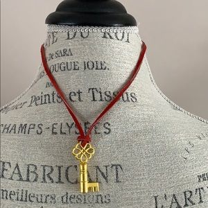 vintage inspired key necklace on red leather cord